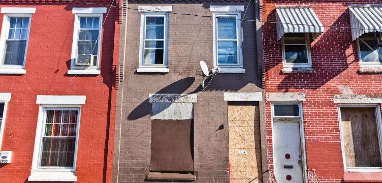 Philadelphia Police Detective Lawrence Greene bought 2931 Waterloo Street, center, in an auction of property seized by the District Attorney.