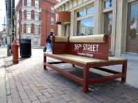 36th and Lancaster trolley bench installed by UCD.
