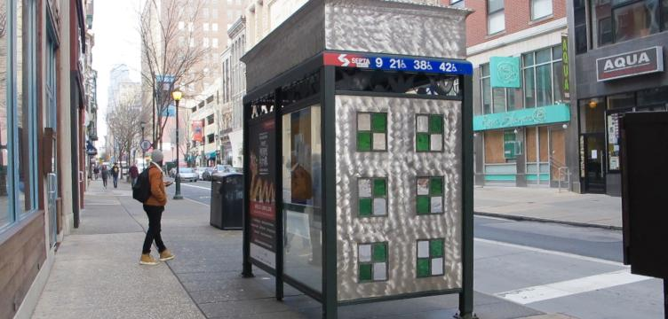 A bus stop at 7th and Chestnut streets, with stained-glass at its eastern side. | Ashley Hahn