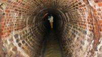 A city worker inspects a sewer in Philadelphia, Pa. (Kimberly Paynter/WHYY)