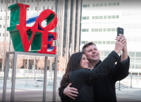 A couple poses at Love Park in February.