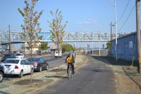 A cyclist cruises on the new Port Richmond Trail's new pervious pavement