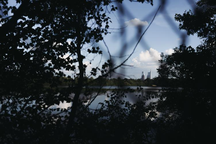 A glimpse of Philadelphia's skyline from the lakeside path at Strawberry Mansion reservoir. | Neal Santos for PlanPhilly