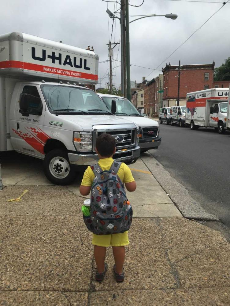 A hazard for kids walking: vehicles cutting off their safe path forward.