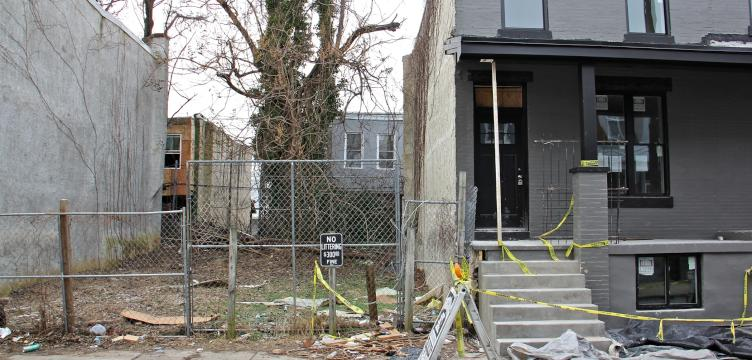 A Philadelphia judge owned this rowhome at 1514 N. Hollywood St. bought the adjacent vacant lots from the city to use as sideyards. He then sold all three properties. (Emma Lee/WHYY)