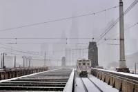 A regional rail train departs 30th Street Station as the snow intensifies. (Emma/Lee/WHYY)