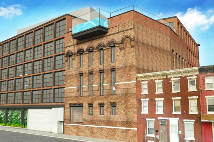 A rendering shows the rooftop swimming pool planned at the back of Roland Kassis's planned hotel in Fishtown, hanging over Leopard Street.