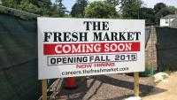 A sign at 8200 Germantown Ave. indicates the Fresh Market will open in fall 2015. (Neema Roshania/WHYY)