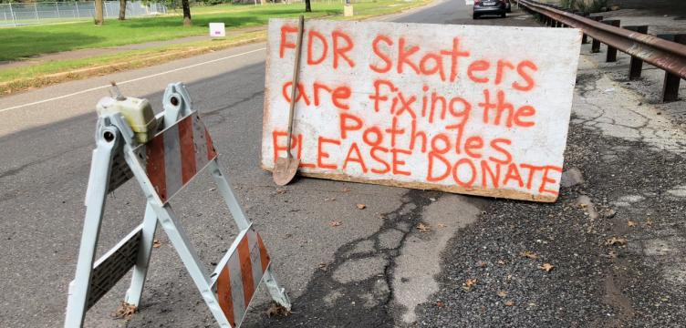 Skaters from FDR Skatepark set up a sign and
