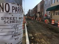 A temporary No Parking sign says street work is schedule from 1/10/18 to T.B.D.