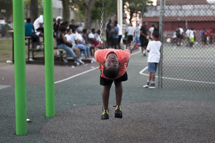 A young Philadelphian looks backwards from his swing at Dendy on the evening of July 18. | Maggie Loesch