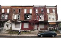 Abandoned houses in between occupied ones on a Hunting Park block similar to Ruth Torres' | via Philadelphia Neighborhoods