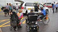 Accessibility activists gather on July 2 to witness Philadelphia's introduction of new wheelchair accessible taxis. (Emma Lee/WHYY)