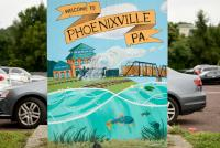 An illustration of a train rolling past the Foundry is found on a utility box at a parking lot along Bridge Street in Phoenixville