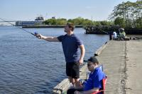 Anglers cast their lines for catfish at Pier 60 off Columbus Boulevard