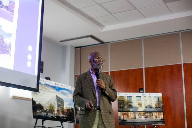 Architect Emmanuel Kelly presents plans for North Station's first phase. (Brad Larrison for WHYY)