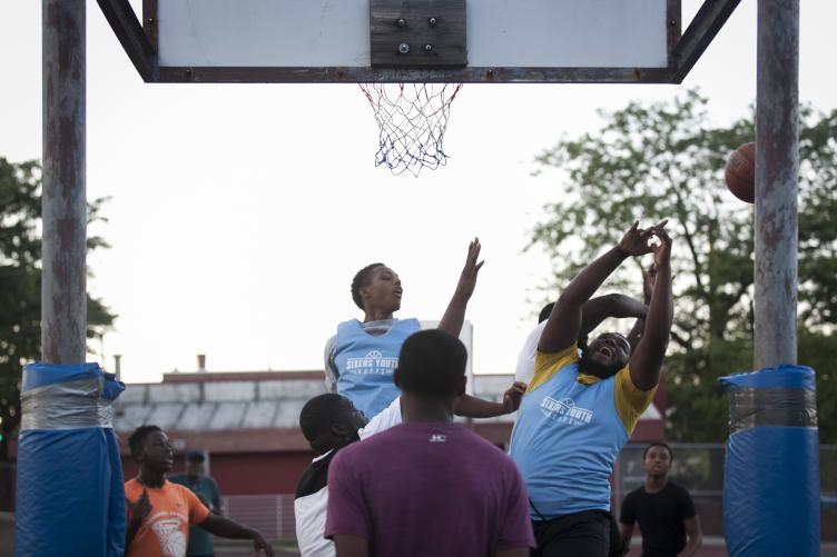 Battling for a rebound on the evening of July 18. | Maggie Loesch