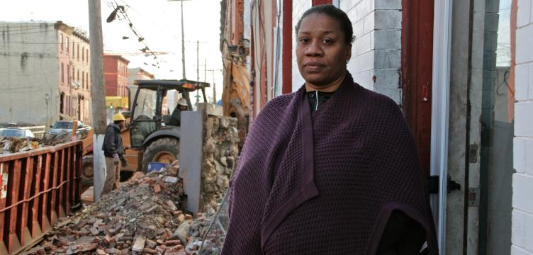 Beatrice Mack, with demolition two doors down. February, 2016 | Emma Lee/WHYY