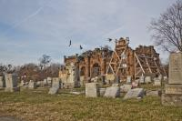 Birds circle Mount Moriah Cemetery's historic gatehouse. (Kimberly Paynter/WHYY)