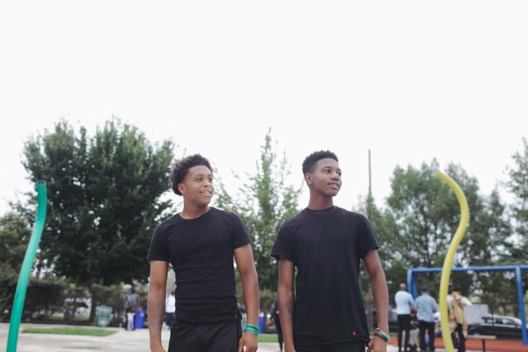 Branden Williams (left) and Kameron Smith want to see more basic park improvements, like water fountains at the basketball courts they use. | Neal Santos for PlanPhilly