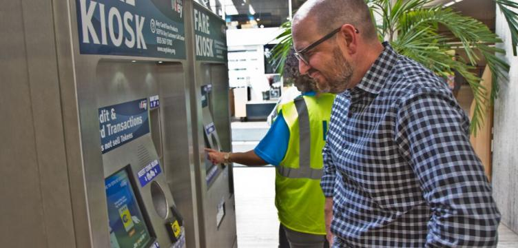 Brian McIntire evaluates the new user interfaces of the SEPTA Key Fare Kiosk (Kim Paynter/WHYYY)