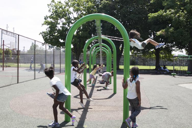 Camp kids play on the swings on the morning of June 29. | Maggie Loesch