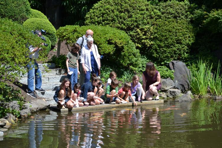 Campers fed koi fish from the restored boat launch and new granite steps