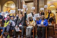 Candidates hold yes signs signaling their agreement with a  proposal at a March candidates forum at Congregation Rodeph Shalom. (Jonathan Wilson for WHYY)