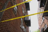 Caution tape surrounds an area at the Chester Hall apartments where a third floor balcony collapsed, critically injuring two men.