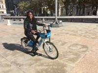 Chamarra McCrorey gives Indego's new e-bikes a test ride on Thomas Paine Plaza