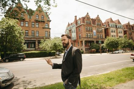 Chris Spahr, director of Centennial Parkside CDC, on Parkside Avenue.  / Neal Santos for PlanPhilly