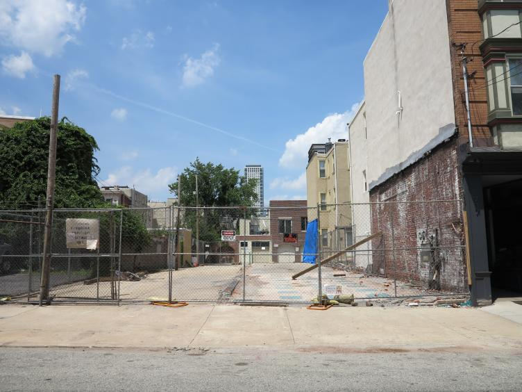 Cleared lots on 700 block of Bainbridge looking north toward Kater, slated for garage-fronted rowhouses
