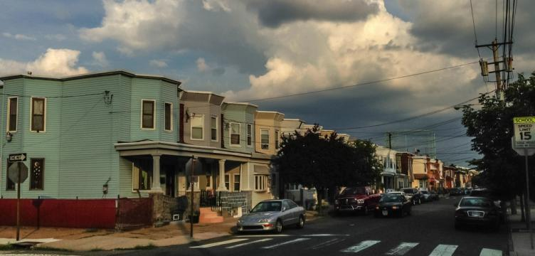 clouds over rowhouses