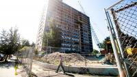 Come Saturday, you won't be able to see the Queen Lane Apartments tower anymore. (Brad Larrison/for NewsWorks)