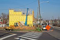 Market-rate town homes are under construction at 3300 Mantua Avenue. Councilwoman Jannie Blackwell steered the lot to the project's developer. (Kimberly Paynter/WHYY)