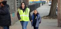Dalia Burgos and her son Albert walk to Lewis Elkin School in Kensington.
