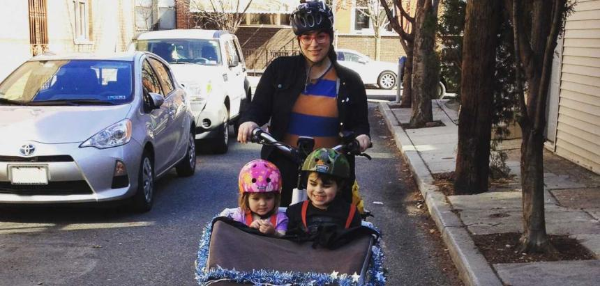Dena Driscoll and her children try to navigate their way to summer camp, blocked by sidewalk parking at 12th Street and Washington Avenue.