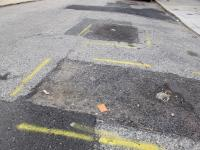 Ditches are not potholes according to the Streets Department's categorization of road defects.