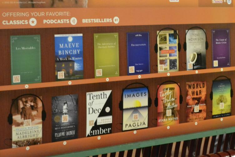 Each book cover included in the library has a QR code which passengers can scan to access the book or podcast content