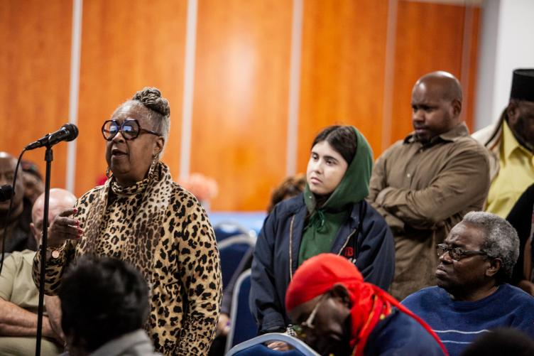 El Amor M. Brawne Ali voiced her opinion on possible community benefits that could be addressed by developers at a recent public meeting. (Brad Larrison for WHYY)