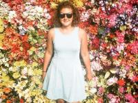 Emily Fredricks pictured in front of a flower wall. (Emily Fredricks Foundation)