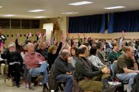 Members showed support for the proposed Fairmount Bike Lanes by raising their pink voting cards