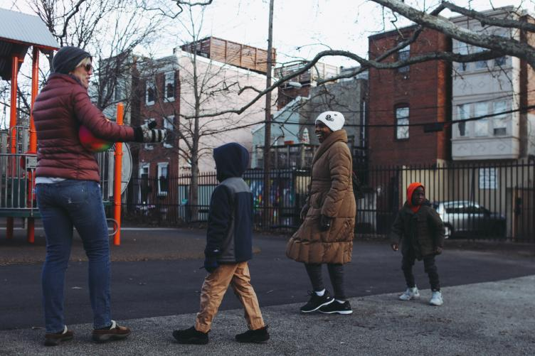 Families at Weccacoe Playground. (Neal Santos for PlanPhilly)