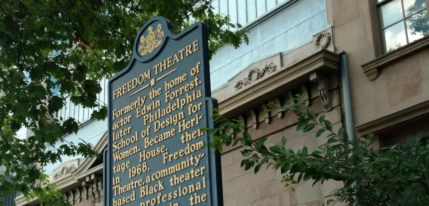 A historical marker for Freedom Theatre, next to new construction along North Broad Street. | Jake Blumgart/PlanPhilly