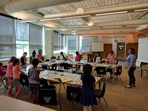 Gabrielle Moshier (right), with some participants at the 2017 Philly Girls Play Chess Camp. | ASAP/After School Activities Partnerships