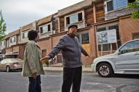 Gerald Renfro and his wife Connie survey the construction on the 6200 block of Osage Avenue.  (Kimberly Paynter/WHYY)