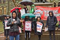 gina dukes a penn alumna and a philadelphia school district teacher speaks at a rally to demand upenn make pilot payments kimberly paynter whyy