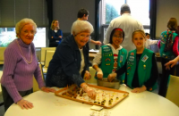 Wesley Enhanced Living at Evangelical Manor residents Alice Kanach (l) and Eleanor Schol (r), along with junior girl scouts from Troop #23463 and #24335 of Mt. Laurel, N.J., make homemade holiday cand