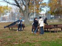 Volunteers help clean the Grove at Lawncrest Rec Center to prepare for the annual Veterans Day celebration