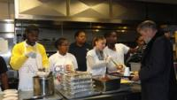 Students from Camelot Schools' Excel Academy South serve the lunch that they prepared to homeless residents of St. John's Hospice in Center City. Photo courtesy of Camelot Schools.